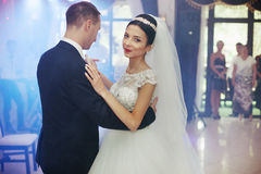 Happy newlywed couple dancing at wedding Royalty Free Stock Images