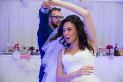 Happy newlywed couple having fun during their first dance at wed. Ding reception Royalty Free Stock Photos