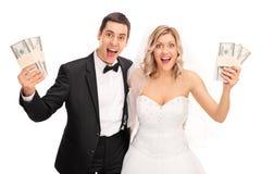 Happy newlywed couple holding money Stock Photography