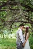 Happy newlywed couple posing at the nature Stock Photo