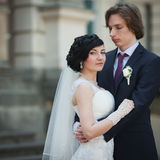 Happy newlywed couple  of valentynes hugging in old european str Royalty Free Stock Photography