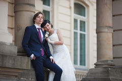 Happy newlywed couple  of valentynes hugging in old european str Royalty Free Stock Photo