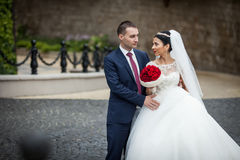 Happy newlywed couple, valentynes, hugging and posing in an old Royalty Free Stock Image