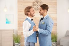 Happy newlywed gay couple dancing royalty free stock photography