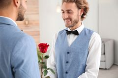 Happy newlywed gay couple with flowe royalty free stock photos