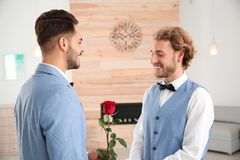 Happy newlywed gay couple with flower royalty free stock photos