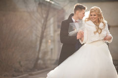 Happy newlywed groom hugging blonde beautiful bride from behind Royalty Free Stock Photos