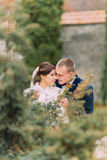 Happy newlywed pair embracing at wedding walk on the beautiful green park.  Stock Image