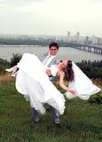 Happy newlyweds. Young happy newlyweds couple outdoors stock image