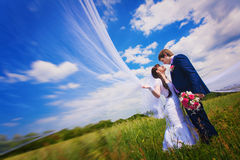Happy newlyweds on the blue sky background Stock Photography
