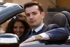 Happy newlyweds in cabrio stock photo