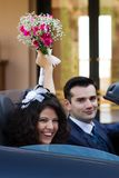 Happy newlyweds in cabrio Royalty Free Stock Photos