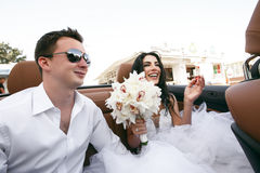 Happy  newlyweds in the car Stock Image