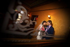 Happy newlyweds in the classic interior Stock Photo