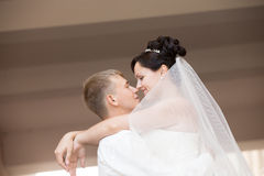 Happy newlyweds dancing and hugging stock photo