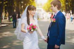 Happy newlyweds in the green park Stock Photo