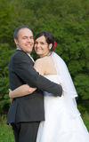 Happy newlyweds hand in hand Stock Image