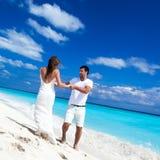 Happy newlyweds having fun on beach Stock Image