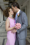Happy newlyweds kissing on street Stock Photography