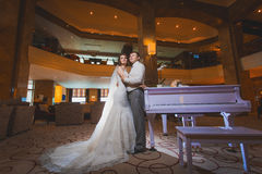 Happy newlyweds in the modern hotel hall Royalty Free Stock Photos