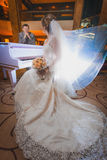 Happy newlyweds in the modern hotel hall Royalty Free Stock Images