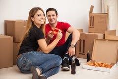 Happy newlyweds moving Royalty Free Stock Images