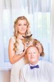 Happy newlyweds near bride and groom wedding royalty free stock photo