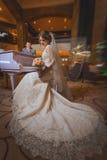 Happy newlyweds near the piano Stock Photos