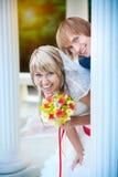 Happy newlyweds near white column. Beautiful happy newlyweds near white column Royalty Free Stock Photography