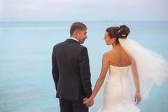 Happy newlyweds outdoor. Royalty Free Stock Photo