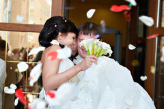 Happy newlyweds and petals Royalty Free Stock Images