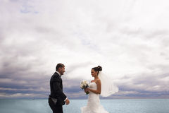 Happy newlyweds on the pier. Royalty Free Stock Image
