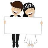 Happy newlyweds smiling Royalty Free Stock Photography
