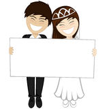 Happy newlyweds smiling Stock Image