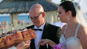 Happy Newlyweds Snap Off a Piece of Wedding Loaf stock video footage