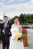 The happy newlyweds on a walk through the city Stock Image
