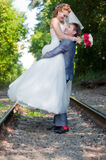 Happy newlyweds on walk Stock Photo