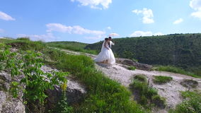 Happy newlyweds walking outdoors on a sunny day.  stock video