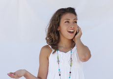 Happy news on cell phone. A girl receives happy news on her cell phone stock photos