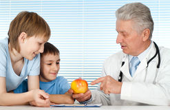 Happy nice Caucasian doctor with patients Stock Photography