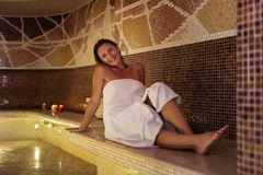 Happy nice woman being in the sauna Stock Photography
