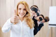 Happy nice woman leading her team Stock Photography