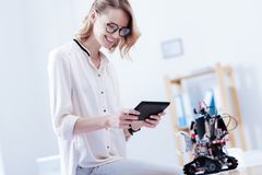Happy nice woman using a tablet royalty free stock photography