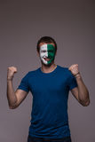 Happy Northern Irishman football fan pray for Northern Ireland national team Stock Photography