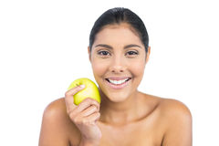 Happy nude brunette holding green apple Stock Photography