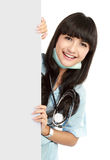 Happy nurse with board Stock Photography