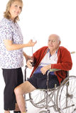 Happy nurse checking elderly patient. Isolated on white Stock Photos