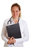 Happy nurse with clipboard Royalty Free Stock Images