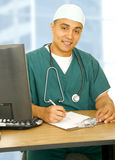 Happy Nurse In His Office Royalty Free Stock Photography