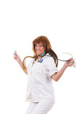 Happy nurse holding stethoscope and syringe jumping Stock Photos